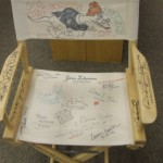 Visiting authors sign the Author Chair at West School